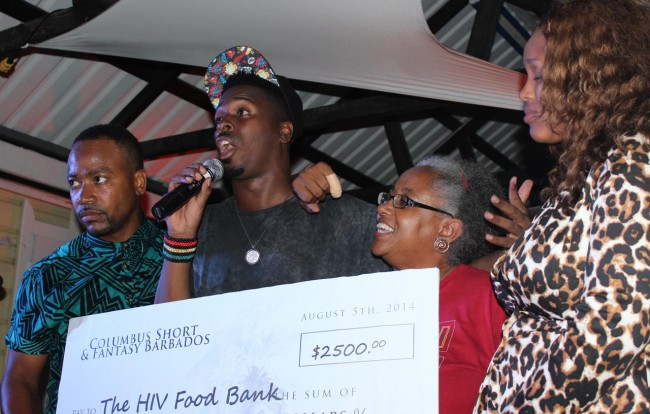 Columbus Short presents all smiles as he presented a cheque to the National HIV Food Bank at last night's benefit event hosted by Muse.