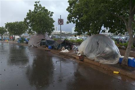Homeless people take shelter in their camp near Kakaako Waterfront Park in Honolulu today