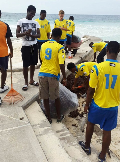 Barbados Under-17 footballers during their clean-up.