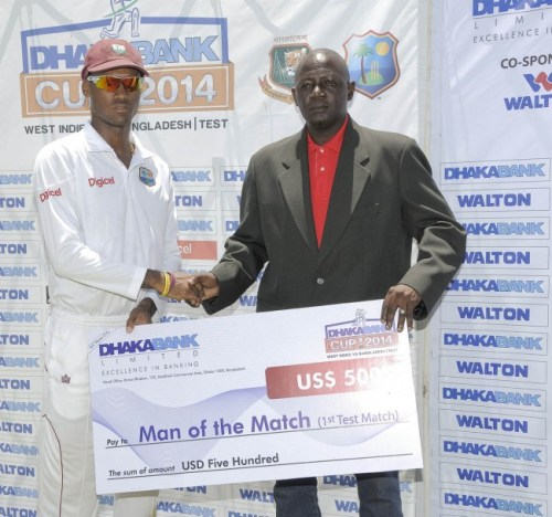 Man-of-the-Match Kraigg Brathwaite (left) collecting his award from former West Indies pacer Ian Allen.