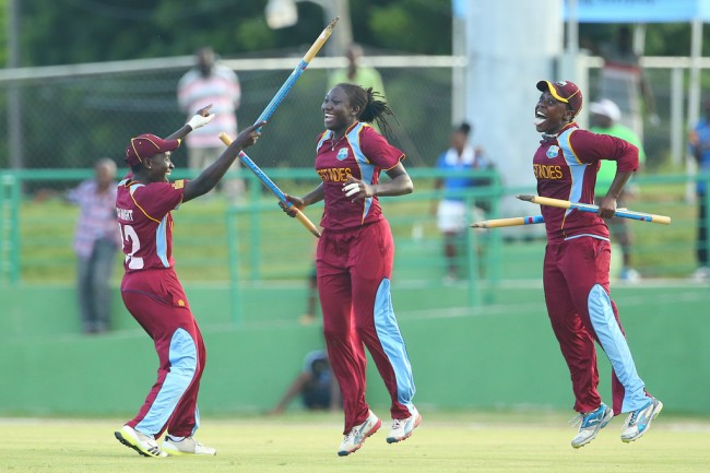 Stafanie Taylor (centre) celebrating victory with teammates Kycia Knight (left) and Shanel Daley.