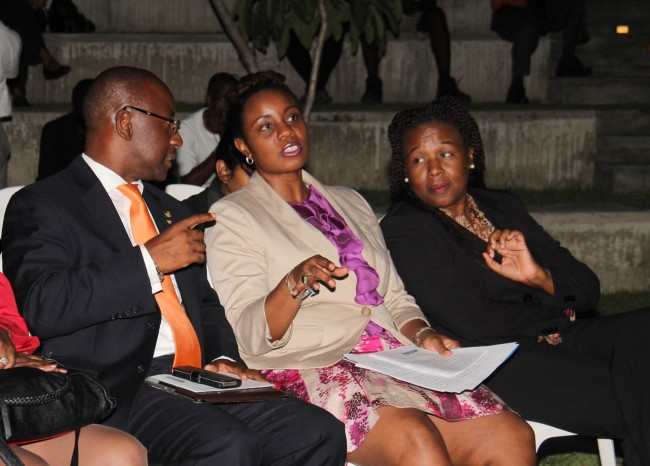 Minister of Culture, Stephen Lashley (right), sharing a word with Tracey Knight-Lloyd (centre), assistant vice president – marketing at Sagicor Life Inc and Lynnette Eastmond, president of the Barbados Film and Video Association.