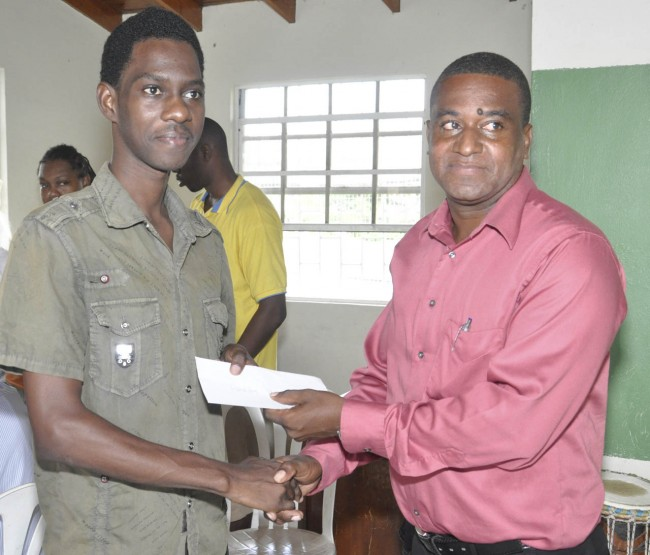 Kevin Benskin (left) a member of the Haynesville Community Group accepting the donation cheque from Dale Haynes, district pastor for the City, North District of the Seventh Day Adventist church.