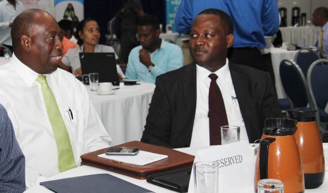CEO of the QEH, Dr Dexter James (left), and Acting Minister of Health Donville Inniss.