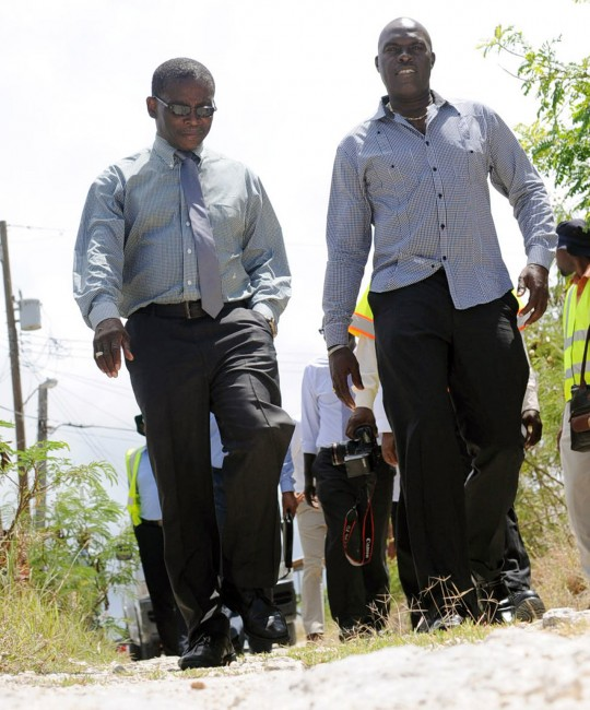 Minister of Transport and Works, Michael Lashley (right) takes a walk at Peterses Road, Josey Hill, St Lucy with MP Dennis Kellman during this morning's tour.