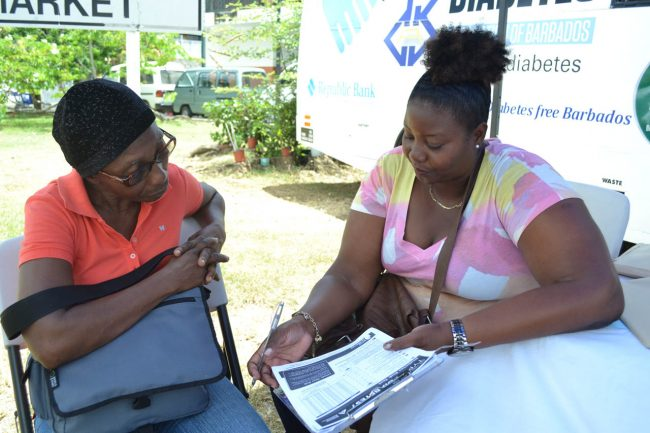 This resident sought information on diabetes from one of the volunteers.