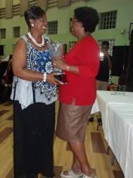 St Thomas MP Cynthia Forde receives the Grantley Adams Award from party leader Mia Mottley.