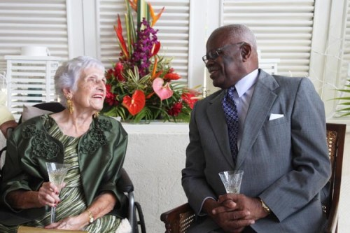 Beulah Mackie in the company of Governor General Sir Elliott Belgrave during her 100th birthday celebrations in May.