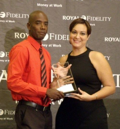 Award recipient Sean Hunte (left) receives his prize from Nunes.