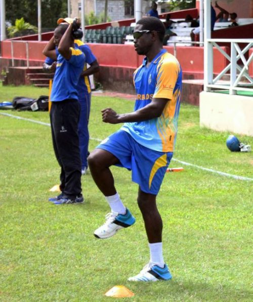Kenroy Williams (right) training today at the Desmond Haynes Oval.