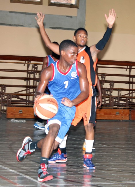 Queen's College guard Devon Deane (with ball) top-scored for his school with 12 points.