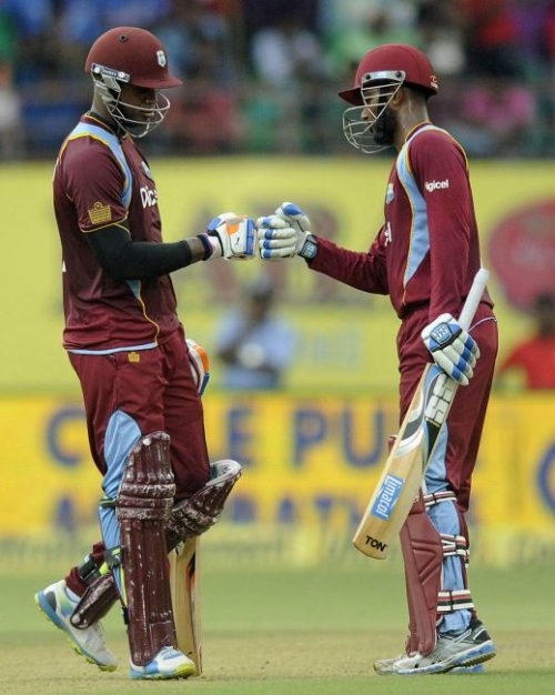 The engine room – Marlon Samuels (left) and Denesh Ramdin's 165-run partnership proved pivotal in the West Indies victory.