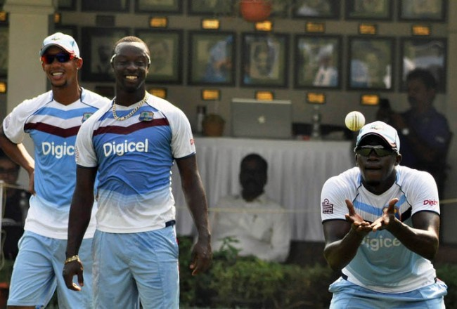West Indies players Jerome Taylor (right), Lendl Simmons (left) and Kemar Roach getting in some practice ahead of tomorrow's ODI.