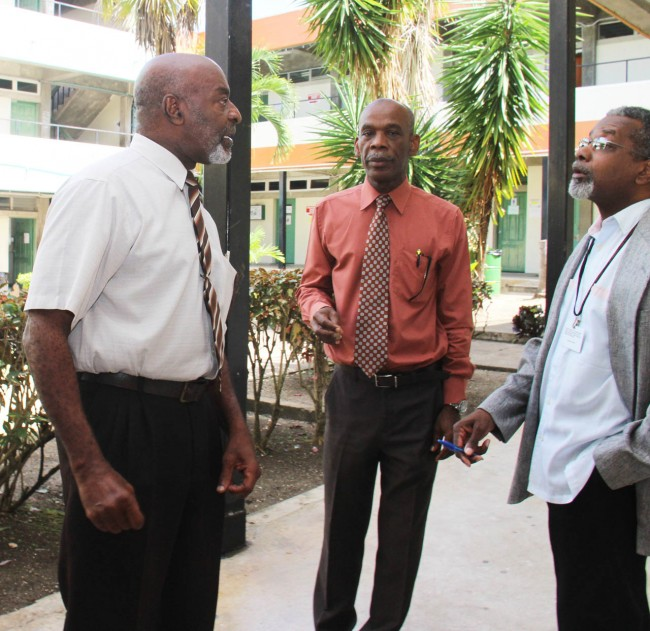 PUT ME OUT! NUPW General Secretary Dennis Clarke has thrown down the gauntlet to management of the Barbados Community College.  Today, he not only challenged them to meet with his union over cost cutting measures at the educational institution, but also to evict him from the campus after he turned up to hold talks     with staff.  Here, Clarke (left) was in a very animated conversation with BCC principal Dr Gladstone Best (centre) and deputy principal Lindsay Waterman (right). (Picture by Remy Rock.)