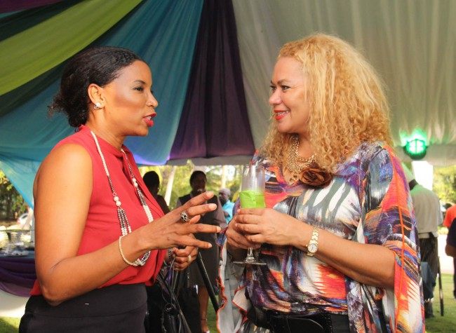 Acting Barbados Tourism Authority CEO Petra Roach (right) with Dawne Williams at the launch of the Food & Wine And Rum Festival.