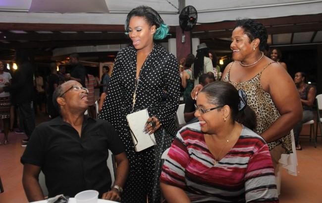 Mahalia mingling with patrons.