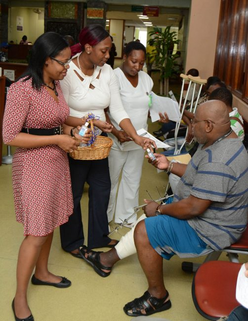Infection control nurses at the Queen Elizabeth Hospital handing out hand sanitizers to patients.