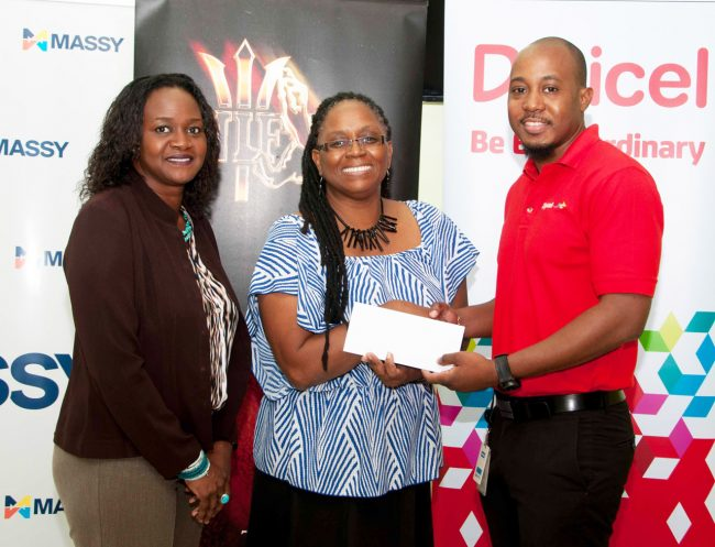 Digicel Marketing Executive Randy Howard presenting the cheque to Chief Cultural Officer of the NCF Andrea Wells. Massy Stores Limited Public Relations Officer Jennifer Branch-Maloney looks on.