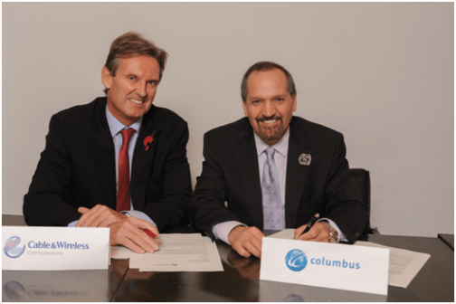 Phil Bentley, chief executive officer of Cable & Wireless Communications (left), and Brendan Paddick, CEO and chairman of Columbus Communications, are all smiles after inking the proposed merger agreement.