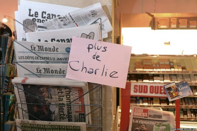 A sign being displayed at a newsagents in Bordeaux. Long queues have formed at news stands in France for the latest edition of satirical magazine Charlie Hebdo, with some selling out early on.