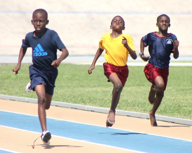 (From left) Victor ludorum Achilles Browne had a comfortable win in the under-11 boys 200m for Blue House.