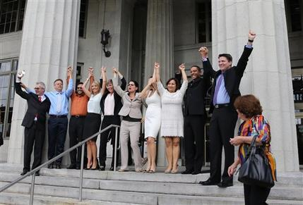 Same-sex couples in Miami celebrating Circuit Court Judge Sarah Zabel's lifting of the legal stay she had placed on her July decision, declaring the wedding ban discriminatory today in Miami.