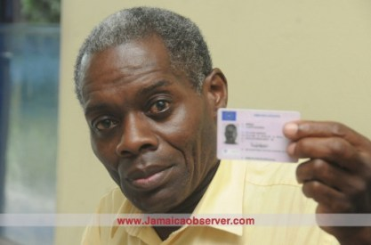 Lloyd Bogle shows his UK driver's licence. (Photo: Jamaica Observer)