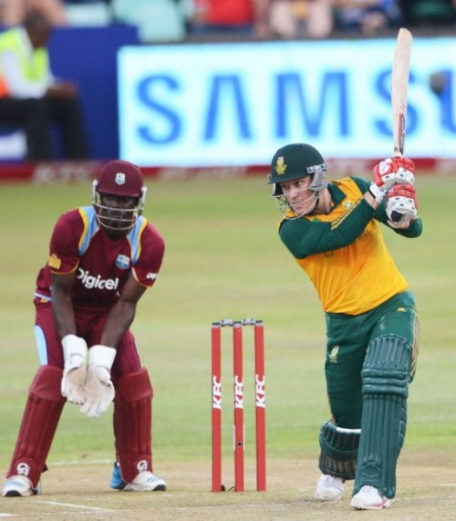 Morne van Wyk drives through the covers during his match-winning century. The wicketkeeper is Andre Fletcher.