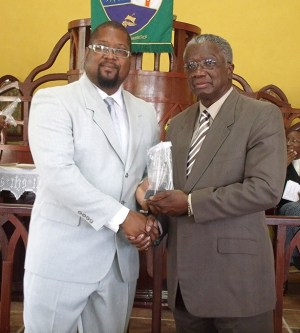 Maurice Pollard receives his award from the Prime Minister.