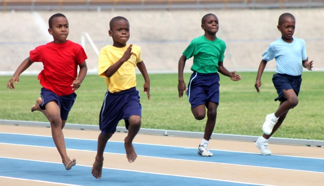 Rashawn Bynoe of Yellow House edged out Nickolai Phillips of Red House to win the under-nine boys 100m.