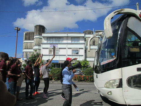 Students of the University of the West Indies blocking the North West gate entrance to the St Augustine Campus. The protest was caused by lecturers witholding their grades.
