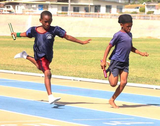 The under-nine boys 4x100m relay brought the entire Stadium to its feet as they witnessed a superb piece of sprinting between Red House's Jordan Hunte and Chrishon Lynch of Green House.