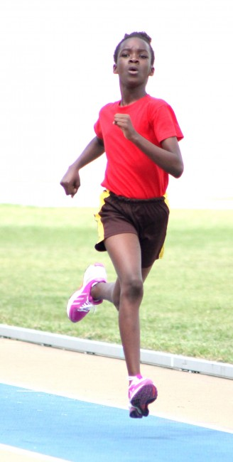 Victrix ludorum Doneisha Moore of Red House won the 200m without breaking a sweat.