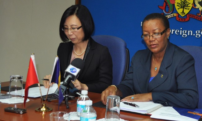 Ambassador of the People's Republic of China to Barbados Wang Ke (left) at the Press conference with Minister of Foreign Affairs Senator Maxine McClean.