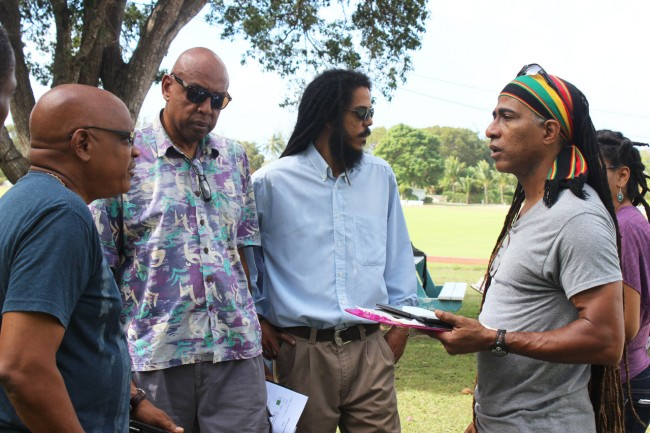 From left, QSI director James Morgan, producer Tom Hinds, workshop coordinator Damien Hinds and technical director Adisa Andweli during the site visit.