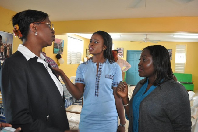 Some of the students, including Judith Luckh (centre) and Ngozi Ogunsuyi (right), shared their concerns with Obiora-Arthur (left) at a Press conference today.