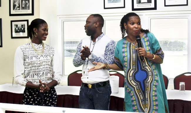 From left, Delta State students Ovuzorie Kome and Samson Ukwedojor singing the piece composed by their colleagues for the programme and being supported by Cheryl Gittens, Managing Director,Paradigm Consultants & Associates.
