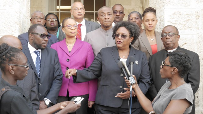 Opposition Leader Mia Mottley flanked by BLP colleagues as she addressed the media this afternoon. (Picture by Rollin Williams.)