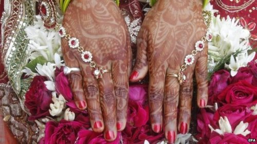 A close-up view of the hands of an Indian bride.