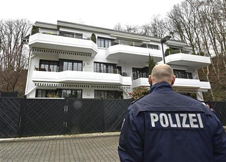 A police officer standing in front of an apartment building where it is believed Andreas Lubitz, the co-pilot of the crashed Germanwings airliner jet, lived in Duesseldorf, Germany, yesterday.
