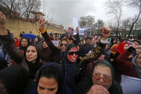 Afghan women chanting slogans during a protest demanding justice for a woman who was beaten to death by a mob after being falsely accused of burning a Quran last week, in downtown of Kabul, Afghanistan, today.