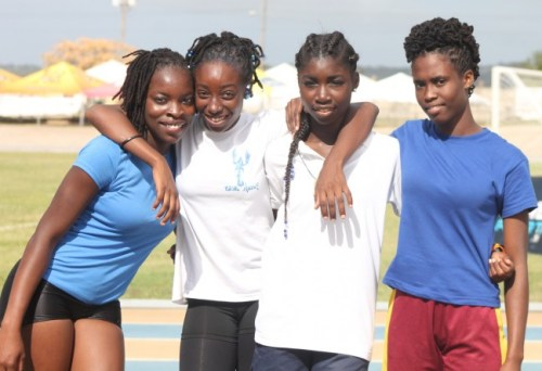 (From left) victrix ludorum Niketa Hackett, Nikita Maughn, Shamikah Norville and Iempress Phillips all played a part in Challenor House's victory in the U20 4X400m relay.