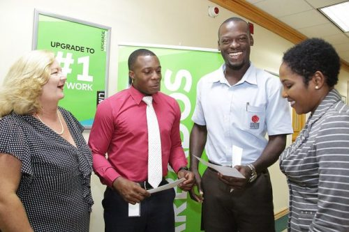 Sheldon Roach (second left) and Daran Gill share a light moment with LIME's Rachel Pilgrim (left) and Marilyn Sealy (right) after officially becoming LIME ambassadors.