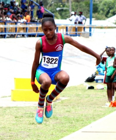 Under-13 girls division champion of St Stephen's Primary, Kiara Payne, jumping to victory with a distance of 4.39m.