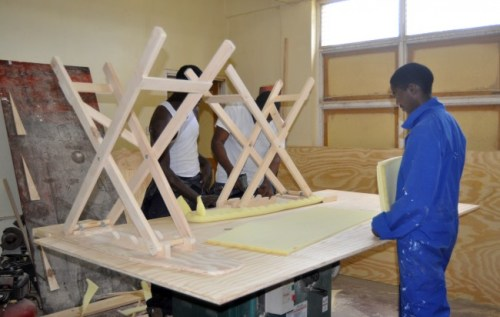 Students busy making ironing boards at the Learning Centre.