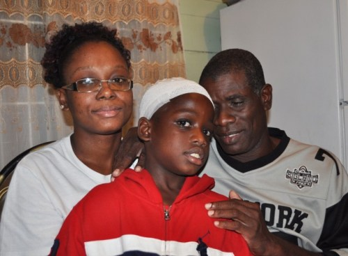 Mother Asha Payne (left) and father Augustus Bertrand are grateful their son Xavier (centre) is still alive.