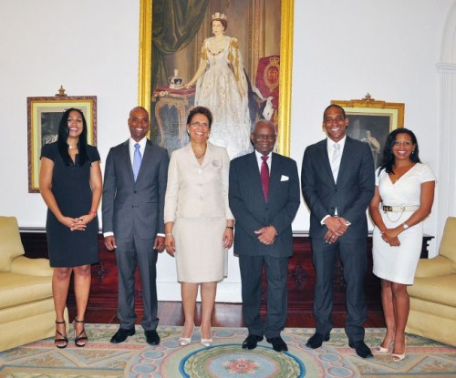 Independent Senator Carol Lady Haynes (third from left) with Governor General Sir Elliott Belgrave (third from right) two sons Kasha (second from left) and Richard (second from right), along with their wives Meredith and Michelle, were in attendance.