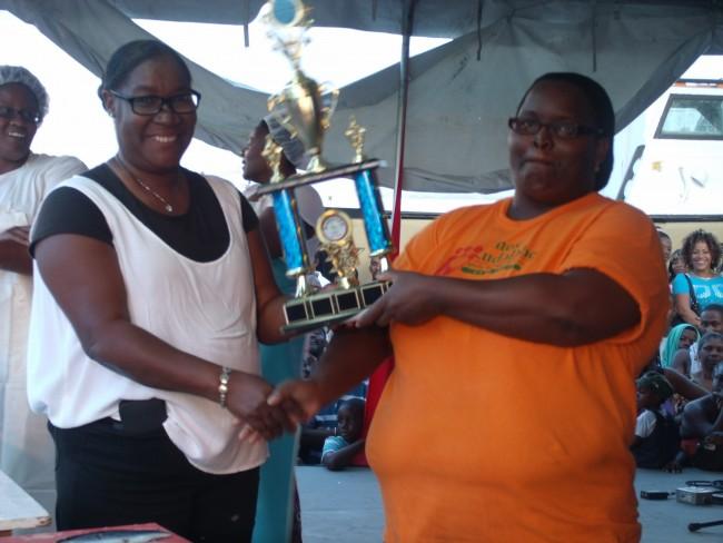 BARNUFO President Vernel Nicholls , left, presents the trophy to Sheena Williams.