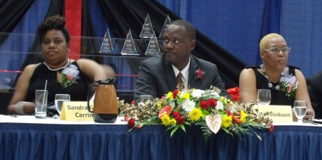 From left, BAOP President Sandra Griffith-Carrington,  Minister of Industry and Commerce Donville Inniss and BAOP life member Jennifer Hinkson during the organisation's 40th anniversary dinner.