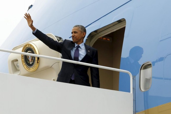 U.S. President Obama waves as he boards Air Force One to travel to Jamaica from Joint Base Andrews